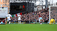 Sunday 07 December 2014<br /> Pictured: Wilfried Bony of Swansea (2nd L) having just scored his opening goal, James Tomkins (4th L) and goalkeeper Adrian of West Ham (R) are licking their wounds<br /> Re: Premier League West Ham United v Swansea City FC at Boleyn Ground, London, UK.