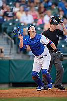 Buffalo Bisons catcher Mike Ohlman (14) looks for a popup in front of umpire Alex Tosi during a game against the Syracuse Chiefs on June 30, 2017 at Coca-Cola Field in Buffalo, New York.  Syracuse defeated Buffalo 8-1.  (Mike Janes/Four Seam Images)