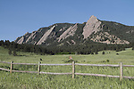 Wood fence and the Flatirons rock formation in Chautauqua Park, Boulder, Colorado, USA .  John leads private photo tours in Boulder and throughout Colorado. Year-round Colorado photo tours.