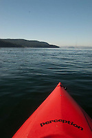 Kayaking at Obstruction Pass off Orcas Island, San Juan Islands, Washington, US