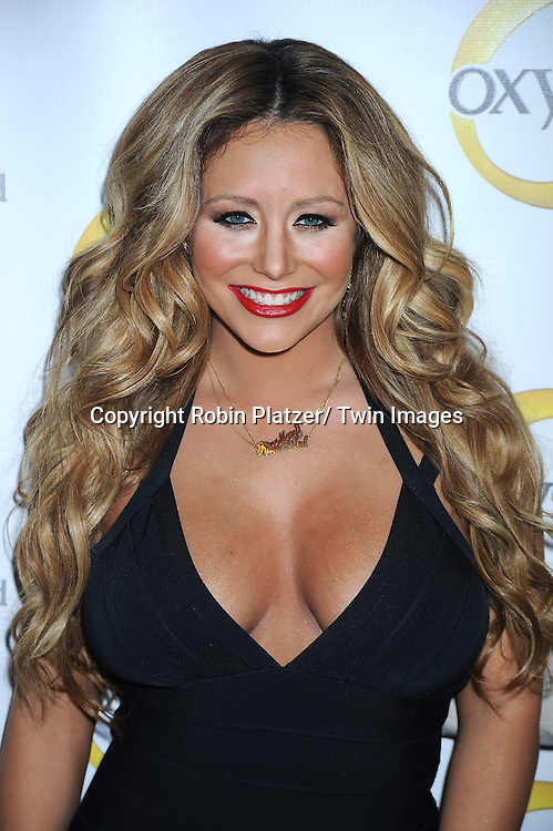 Aubrey O' Day attending the Oxygen Upfront on April 4, 2011 at Gotham Hall in New York City.