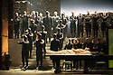 London, UK. 30.04.2014. English National Opera gives the world premiere of British composer Julian Anderson's first opera, THEBANS. Picture shows: Matt Casey (Eteocles) and citizens of Thebes. Photograph © Jane Hobson.