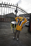 Prescot Cables 2 Brighouse Town 1, 13/02/2016. Hope Street, Northern Premier League. A home fan putting on his ceremonial drum before Prescot Cables played Brighouse Town in a Northern Premier League division one north fixture at Valerie Park. Founded in 1884, the 'Cables' in their name came from the largest local employer, British Insulated Cables and they have played in their current ground, also known as Hope Street, since 1906. Prescott won the match 2-1 watched by a crowd of 189. Photo by Colin McPherson.