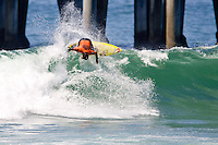 Hawaiian Kekoa Bacalso cracks the lip during round of 96 of the 2010 US Open of Surfing in Huntington Beach, California on August 4, 2010.