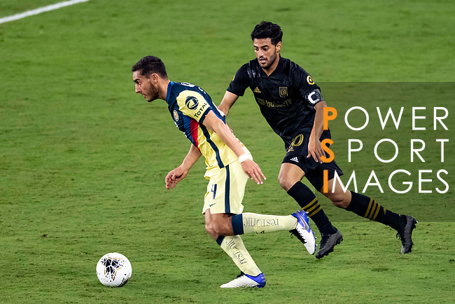 Carlos Vela of Los Angeles FC (USA) in action against Sebastian Caceres of Club America (MEX) during their CONCACAF Champions League Semi Finals match at the Orlando's Exploria Stadium on 19 December 2020, in Florida, USA. Photo by Victor Fraile / Power Sport Images