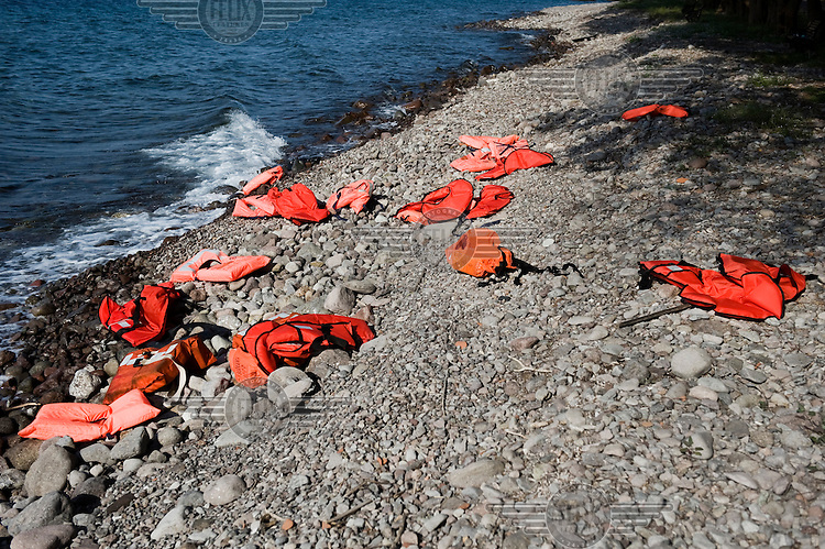 Discarded lifejackets lie on the beach near Skala Sykaminias on Lesbos island in Greece.Every day hundreds of refugees, mainly from Syria and Afghanistan, are crossing in small overcrowded inflatable boats the six mile channel from the Turkish coast to the island of Lesbos in Greece. Many spend their life savings, over $1,000, to buy a space on these boats.