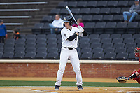 DJ Poteet (4) of the Wake Forest Demon Deacons at bat against the Sacred Heart Pioneers at David F. Couch Ballpark on February 15, 2019 in  Winston-Salem, North Carolina.  The Demon Deacons defeated the Pioneers 14-1. (Brian Westerholt/Four Seam Images)