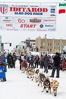 Grayson Bruton and team leave the ceremonial start line with an Iditarider and handler at 4th Avenue and D street in downtown Anchorage, Alaska on Saturday March 7th during the 2020 Iditarod race. Photo copyright by Cathy Hart Photography.com