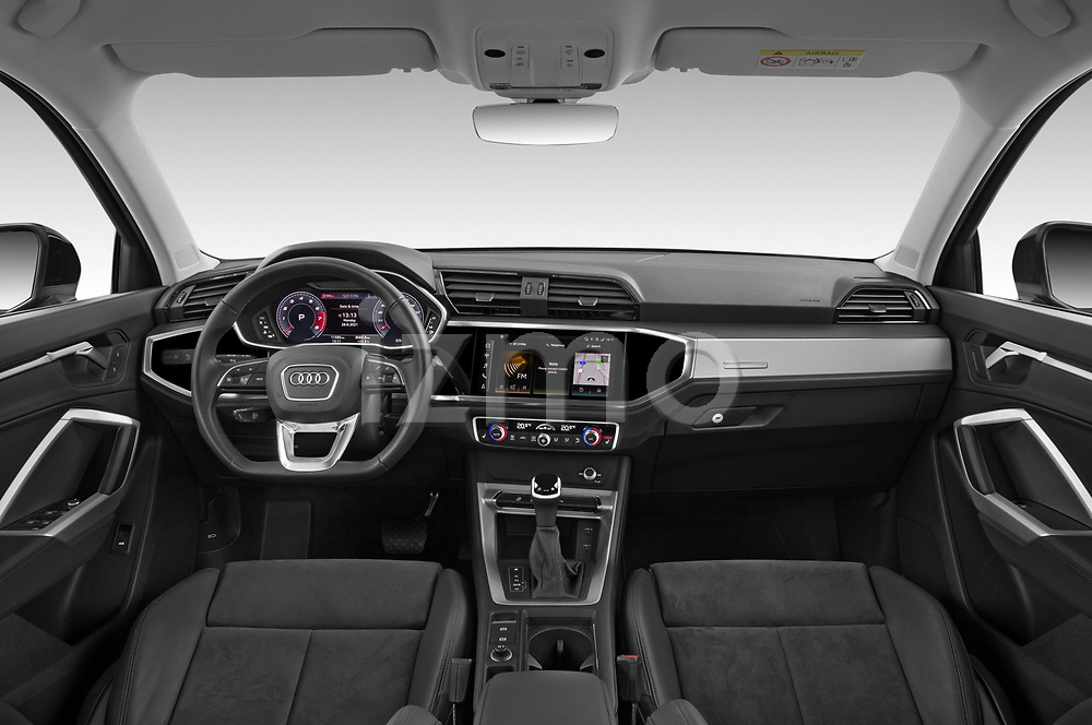 Stock photo of straight dashboard view of 2021 Audi Q3 S-line 5 Door SUV Dashboard