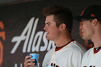SAN FRANCISCO, CA - APRIL 27:  Christian Arroyo #22 of the San Francisco Giants sits in the dugout and drinks Powerade during the game against the Los Angeles Dodgers at AT&T Park on Thursday, April 27, 2017 in San Francisco, California. (Photo by Brad Mangin)