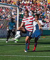 Alex Morgan (13) of the USWNT takes control of the ball in front of Daniela Cruz (8) of Costa Rica during a friendly match at Sahlen's Stadium in Rochester, NY.  The USWNT defeated Costa Rica, 8-0.