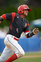Batavia Muckdogs second baseman J.C. Millan (4) runs to first base after hitting a double during a game against the West Virginia Black Bears on June 25, 2017 at Dwyer Stadium in Batavia, New York.  Batavia defeated West Virginia 4-1 in nine innings of a scheduled seven inning game.  (Mike Janes/Four Seam Images)
