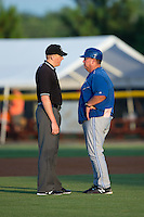 Umpire Grant Hinson explains a call to Bluefield Blue Jays manager Dennis Holmberg (35) during the game against the Burlington Royals at Burlington Athletic Stadium on June 28, 2016 in Burlington, North Carolina.  The Royals defeated the Blue Jays 4-0.  (Brian Westerholt/Four Seam Images)