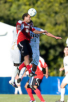 Louisville's Nick DeLeon (14) battles Akron's Perry Kitchen (5). 2010 NCAA D1 College Cup Championship Final Akron defeated Louisville 1-0 at Harder Stadium on the campus of UCSB in Santa Barbara, California on Sunday December 12, 2010.