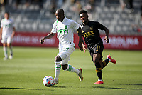 LOS ANGELES, CA - APRIL 17: Kekuta Manneh #23 of Austin FC moves with the ball during a game between Austin FC and Los Angeles FC at Banc of California Stadium on April 17, 2021 in Los Angeles, California.