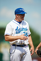 Lexington Legends manager Scott Thorman (35) meets with home plate umpire John Budka during a game against the Rome Braves on May 23, 2018 at Whitaker Bank Ballpark in Lexington, Kentucky.  Rome defeated Lexington 4-1.  (Mike Janes/Four Seam Images)