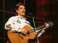 Undated file photo, Montreal, Quebec, Canada<br /> <br /> French singer  Francis Cabrel during a Television show recorded at the Montral Spectrum<br /> <br /> <br /> NOTE 35mm slide scanned with Kodak RFS 3600,saved in Adobe 1998 RGB.<br /> NO UNSHARP MASK APPLIED