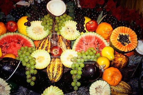 Porto Seguro, Bahia State, Brazil; display of fruit; melon, watermelon, grapes, papaya, cacau, pear, apple, coconut etc.