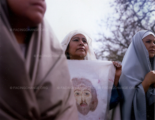 Chicago, Illinois<br /> USA<br /> April 2010<br /> <br /> Women hold a claw with a picture of Jesus Christ at a Good Friday procession in Chicago. Pilsen is mostly a Mexican American community in Chicago. ( this image is a double exposure and was an accident)