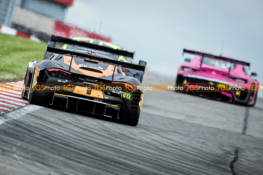 Morgan Tillbrook & Marcus Clutton, McLaren 720S GT3, Enduro Motorsport chases Andrew Howard & Jonny Adam, Aston Martin Vantage AMR GT3, Beechdean AMR and Ian Loggie & Yelmer Buurman, Mercedes AMG GT3, RAM Racing out of Melbourne during the British GT & F3 Championship on 11th July 2021