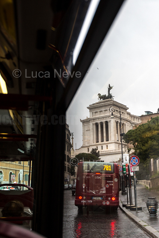 Altare della Patria.<br /> <br /> Rome, Italy. 17th Mar, 2021. Documenting Rome from a Bus window (Number 81) and during a quick walk in the City center, while the new and tougher Covid-19 restrictions, imposed by Mario Draghi's Government, have been implemented since Monday morning in Rome, its surrounding Lazio Region, and other 9 Regions, including: Lombardia, Campania, Molise, Emilia Romagna, Friuli-Venezia Giulia, Marche, Piemonte, Puglia, Veneto and Autonomous Province of Trento. The local authorities tightened rules and restrictions due to a spike in the Covid-19 / Coronavirus cases. A new self-certification (autocertificazione, downloadable from here 1.) is needed to leave home which is allowed only for urgent reasons, mainly work and health. Italy will be placed under nationwide lockdown over the Easter weekend. <br /> <br /> Footnotes & Links:<br /> 1. http://www.regione.lazio.it/binary/rl_main/tbl_news/autocertificazione_1_.pdf