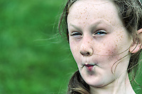 Young girl making a puckered funny face.