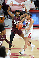 Arkansas guard Chelsea Dungee (33) passes Thursday, Feb. 11, 2021, in the lane around Mississippi State forward Rickea Jackson (5) during the first half of play in Bud Walton Arena. Visit nwaonline.com/210212Daily/ for today's photo gallery. <br /> (NWA Democrat-Gazette/Andy Shupe)