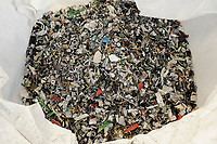 GERMANY, Hamburg, recycling of electronical scrap and old consumer goods at company TCMG, the trash is collected by the urban waste disposal system and than processed and separated here after metals like copper and plastics for further recycling and reuse, by law is not allowed to export e-scrap to africa and other countries, metal granulate