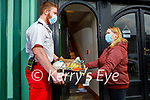 Thomas White of the Tralee Branch of the Irish Red Cross makes a delivery to Eileen Sheehy in Castleisland on Monday.