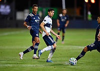 LAKE BUENA VISTA, FL - JULY 26: Cristián Gutiérrez of Vancouver Whitecaps FC plays the ball back during a game between Vancouver Whitecaps and Sporting Kansas City at ESPN Wide World of Sports on July 26, 2020 in Lake Buena Vista, Florida.