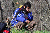 Pictured: A desperate stranded migrant at Tempe Thursday 25 February 2016<br />Re: Hundreds of migrants, including families with young children, that were stranded at Tempe in central Greece, were forced to walk on foot on the motorway to reach Idomen, about 168 kilometres away, in the northern part of the country, at the Greek FYRO Macedonian border. Local police were at first escorting them, then made sure that they were safely transported on coaches.