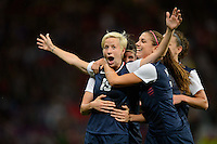Manchester, England - Monday, August 6, 2012: The USA defeated Canada 4-3 in overtime in the semi-final round of the 2012 London Olympics at Old Trafford. Megan Rapinoe celebrates her goal with Alex Morgan.