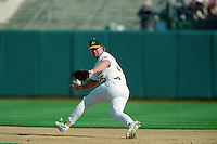 OAKLAND, CA - Mark McGwire of the Oakland Athletics fields a ground ball at first base during a game at the Oakland Coliseum in Oakland, California in 1990. Photo by Brad Mangin