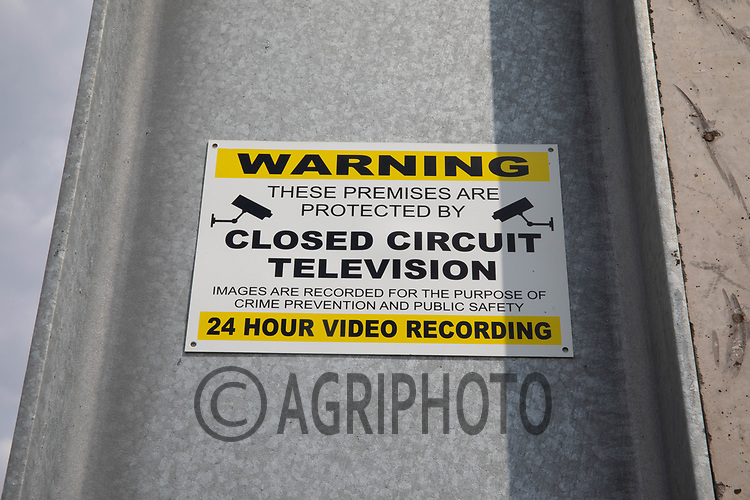 Closed circuit television camera warning sign in a farmyard <br /> ©Tim Scrivener Photographer 07850 303986<br />      ....Covering Agriculture In The UK....