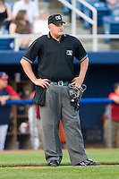 Home plate umpire Tyler Wilson between innings of the Carolina League game between the Kinston Indians and the Salem Red Sox at Lewis-Gale Field May 1, 2010, in Winston-Salem, North Carolina.  Photo by Brian Westerholt / Four Seam Images