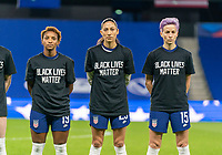 LE HAVRE, FRANCE - APRIL 13: Crystal Dunn #19, Christen Press #23 and Megan Rapinoe #15 of the USWNT line up while wearing black lives matter t-shirts during a game between France and USWNT at Stade Oceane on April 13, 2021 in Le Havre, France.
