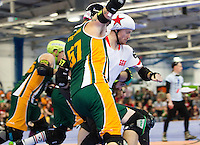 15 MAR 2014 - BIRMINGHAM, GBR - Team England jammer Reaper forces his way through the Wizards of Aus blockers during the inaugural Men's Roller Derby World Cup at the Futsal Arena in Birmingham, West Midlands, Great Britain (PHOTO COPYRIGHT © 2014 NIGEL FARROW, ALL RIGHTS RESERVED)