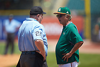 Miami Hurricanes head coach Jim Morris discusses a call with home plate umpire Jay Asher during the game against the Wake Forest Demon Deacons in Game Nine of the 2017 ACC Baseball Championship at Louisville Slugger Field on May 26, 2017 in Louisville, Kentucky. The Hurricanes defeated the Demon Deacons 5-2. (Brian Westerholt/Four Seam Images)