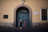 Tourists make their way past gates for Hotel du Tasso on Thursday, Sept. 17, 2015, in Sorrento, Italy. (Photo by James Brosher)