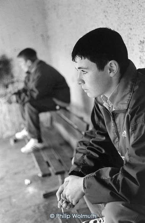 Two teenagers pass the afternoon smoking in a town-centre bus shelter in Liskeard, Cornwall