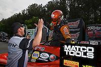 May 11, 2013; Commerce, GA, USA: NHRA funny car driver Johnny Gray celebrates with son Shane Gray (left) after winning the Southern Nationals at Atlanta Dragway. Mandatory Credit: Mark J. Rebilas-