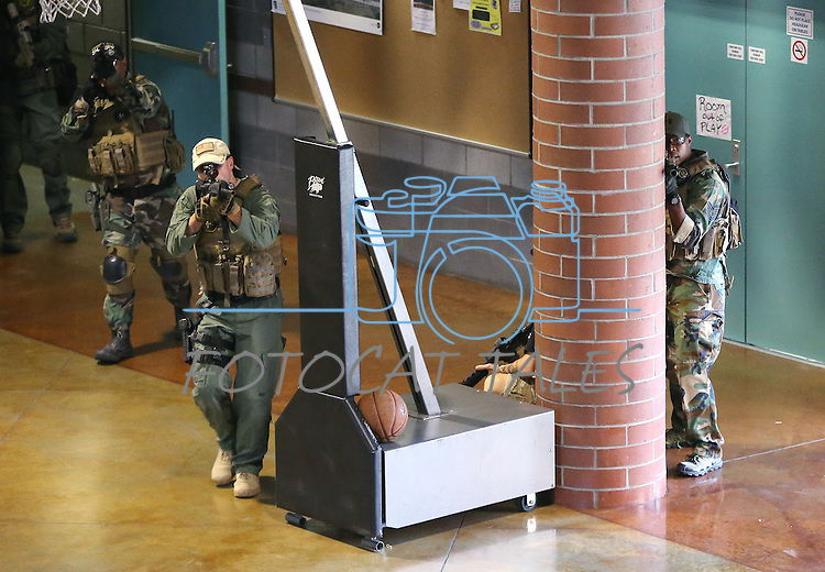Carson City Sheriff's SWAT members respond to an active shooter drill at the Adjutant General complex in Carson City, Nev., on Wednesday, July 22, 2015. Nevada National Guard, Carson City Sheriff and Fire departments and Nevada Division of Emergency Management were all part of the exercise.<br /> Photo by Cathleen Allison