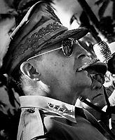 """1944 - Exact Date Shot Unknown - General MacArthur surveys the beachhead on Leyte Island, soon after American forces swept ashore from a gigantic liberation armada into the central Philippines, at the historic moment when the General made good his promise """"I shall return"""".  1944. (Coast Guard)"""