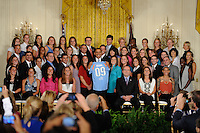 President Barack Obama holds a Sky Blue FC jersey as he poses for photos with reigning Women's Professional Soccer (WPS) champions Sky Blue FC in the East Room of the White House in Washington, D. C., on July 01, 2010.
