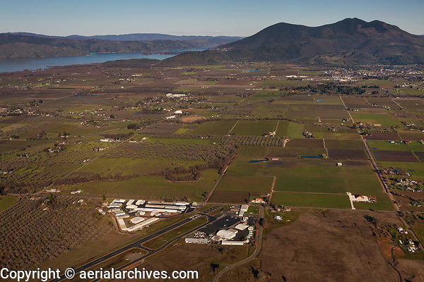 aerial photograph of Lampson Field airport (1O2), Lakeport, Lake County, California with Kelseyville, Mount Konocti and Clear Lake in the background.
