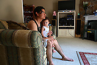 28 year old Danny Savalba, a Honduran immigrant, sits in his home in Manassas, Virginia with his one year old daughter Alison. His house has plummeted in value over the last year from 295,000 USD to 150,000, and for the past six months Danny has not been paying his mortgage. Soon they will be moving out. The area is suffering from a major collapse in the housing market following the subprime crisis and global credit crunch, which has forced the foreclosure and abandonment of numerous properties...