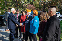 Vice President Mike Pence is greets a Veterans Service member upon his arrival to the National Veterans Day Observation at Arlington National Cemetery, Arlington, Virginia, Nov. 11, 2019. Vice President Pence with Secretary of Veterans Affairs Robert Wilkie participated in a wreath-laying ceremony at the Tomb of the Unknown Soldier and spoke to the crowd in the Memorial Amphitheatre as part of the observance. (U.S. Army photo by Elizabeth Fraser / Arlington National Cemetery / released)