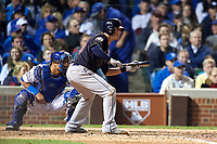 Cleveland Indians Tyler Naquin (30) squares to bunt in front of catcher Wilson Contreras in the seventh inning during Game 3 of the Major League Baseball World Series against the Chicago Cubs on October 28, 2016 at Wrigley Field in Chicago, Illinois.  (Mike Janes/Four Seam Images)