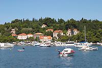 Pleasure boats moored on buoys and along the key, villas along the coast. Luka Gruz harbour. Dubrovnik, new city. Dalmatian Coast, Croatia, Europe.