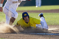 Michigan Wolverines outfielder Jackson Glines (27) is picked off at first base during the NCAA season opening baseball game against the Texas State Bobcats on February 14, 2014 at Bobcat Ballpark in San Marcos, Texas. Texas State defeated Michigan 8-7 in 10 innings. (Andrew Woolley/Four Seam Images)